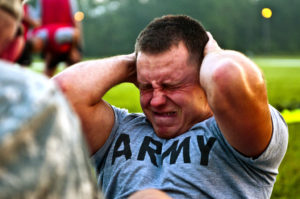 Sgt. David W. Rider, a 2010 Army Reserve Best Warrior competitor and practical nurse from Strongsville, Ohio, assigned to Bravo Company, 256th Combat Support Hospital, grimaces during the push-up event while taking the Army Physical Fitness Test at Fort McCoy, Wis., July 26, 2010.