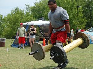 Read more about the article | Loaded Carries – Walk Your Way to Gains |