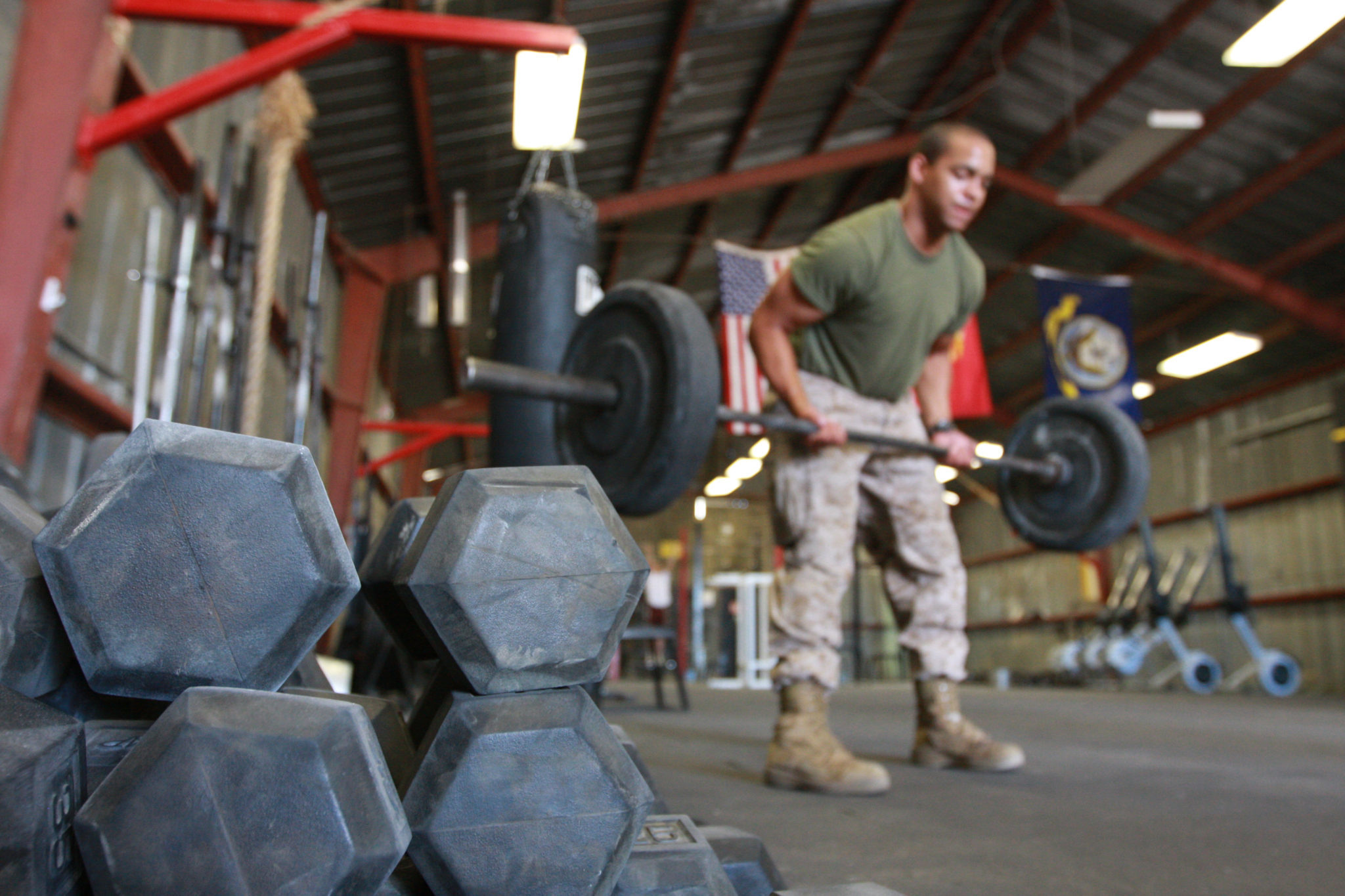 solider performing military fitness training to failure with weights